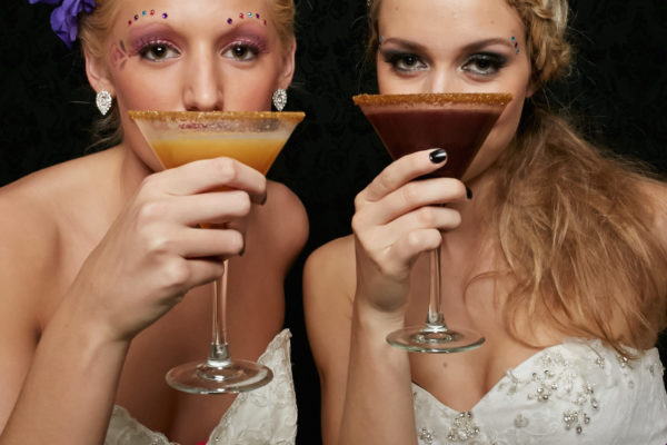 two beautiful brides toasting